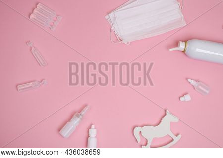 Different Types Of Medical Drops, Nasal Spray On Pink Background. Pediatrics Concept; Children's Med