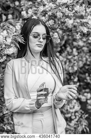 Aroma Compounds. Luxury Fragrance. Fashionable Woman Hold Perfume Bottle. Cherry Blossom Aroma. Fema