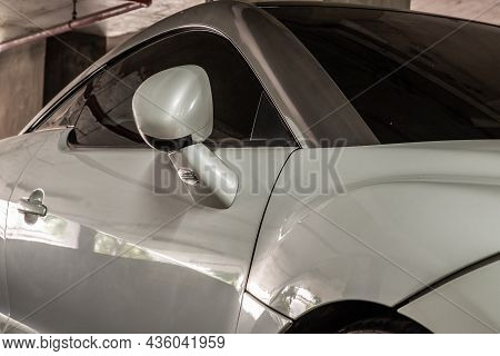 Bangkok, Thailand - 31 Aug 2021 : Side View Of Car Headlights Of White Peugeot Rcz Sports Car Parked