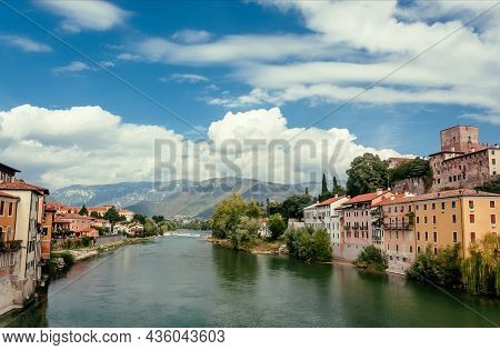Clouds Over Old Italian Town Bassano Del Grappa In Veneto Region And River Between Historical Areas,