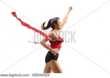 Young female runner on the finish line of a marathon isolated on white background