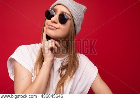 Closeup Of Young Positive Thoughtful Beautiful Charming Dark Blonde Woman With Sincere Emotions Wear