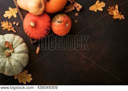 Pumpkin. Autumn Food Background With Cinnamon, Nuts And Seasonal Spices On Brawn Rustic Background.