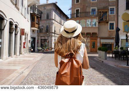 Traveler Backpacker Girl Walking In Historic City Street