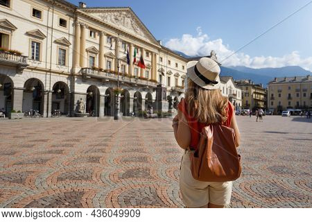 Young Tourist Woman Visiting Piazza Émile Chanoux Square In Aosta City, Italy