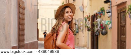Tourism In Sardinia. Panoramic Banner View Of Traveler Girl Walking In Picturesque Narrow Alley Of A