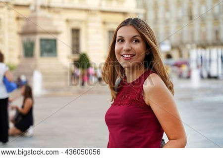 Pretty Smiling Woman Walking In The City Looking Around. Waist Up.