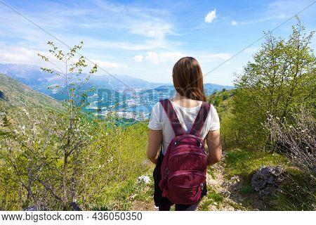 Female Hiker Trekking On Mountains Enjoying View From Belvedere