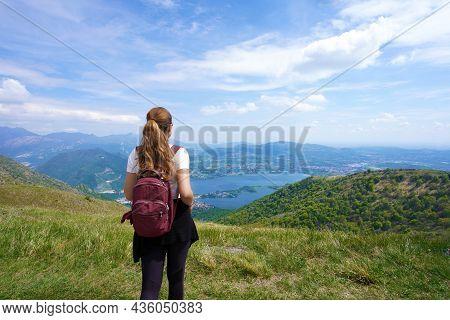 Female Hiker Enjoying Landscape After Trekking On Mountains From Belvedere