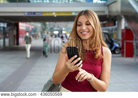 Charming Beautiful Business Woman Smile In Casual Style Using Smartphone Walking In Train Or Metro S