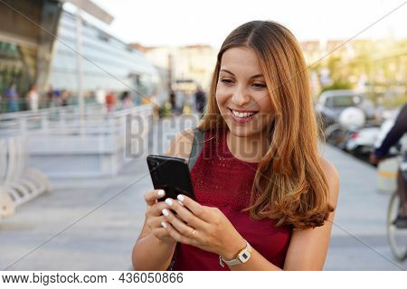 Lifestyle Portrait Of Business Woman On Evening City Using Smartphone App, Casual Girl Typing Text M