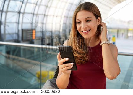 Travel And Technology. Excited Young Woman Receiving Good News On Her Smartphone Waiting For Boardin