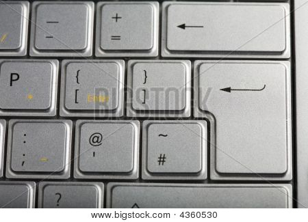 Section Of A Silver Laptop Keyboard