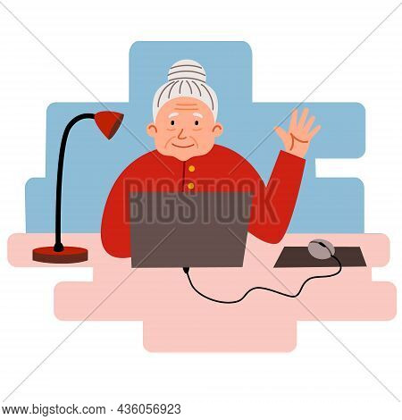 An Elderly Woman Works At Home At A Computer. Cute Granny Is Sitting At Her Desk And Working.