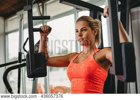 Young Fitness Woman Exercise With Exercise-machine In Gym. Health Sport Fit People Concept