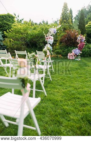 Wedding Ceremony In The Beautiful Landscaping Garden Among Lawn With Stylish Wedding Arch Decorated