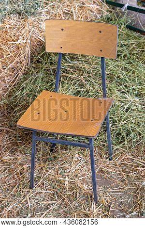 One Wooden Chair In Hay Straw Barn Farm