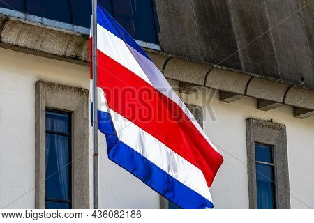 Flag Of Costa Rica Old Buildings Behind Costa Rican Flag.