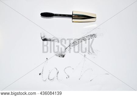 Shot Of Smudged Black Mascara Isolated On White Background. Cosmetic Product Swatch. Paint Brush Str