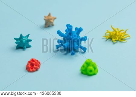 Different Viruses And Bacteria On A Blue Background
