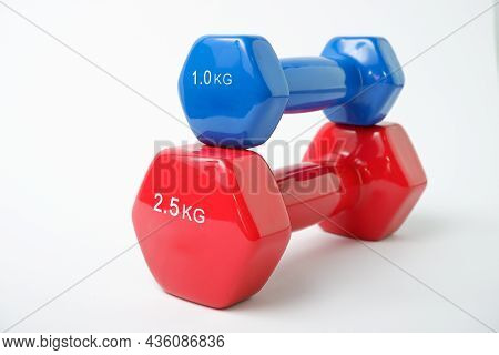 Simple Dumbbell. Blue And Red Dumbbells For Fitness On A White Background.