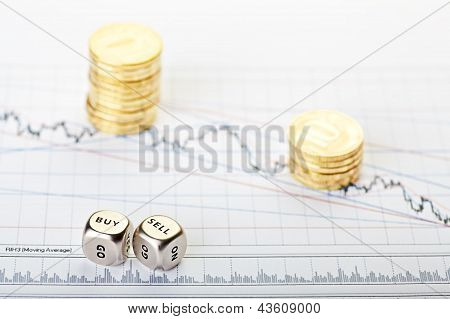 Downtrend Stacks Of Coins And Dices Cubes With The Words Sell Buy On Financial Chart. Selective Focu