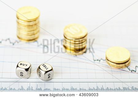 Dices Cubes With The Words Sell Buy And Golden   Stack Coins On Financial Chart Downtrend. Selective