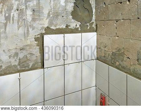 Laying Of New Ceramic Tiles On The Wall, Beginning Of Laying Tiles On The Wall, Construction Work, R