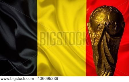 6 October 2021 Brussels, Belgium. Fifa World Cup Cup Against The Background Of The Flag Of Belgium.