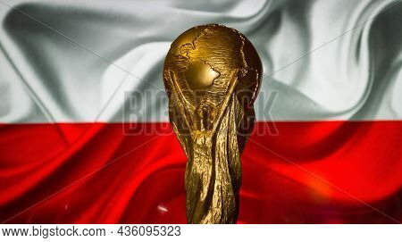 October 6, 2021 Warsaw, Poland. Football World Cup Cup Against The Background Of The Flag Of Poland.
