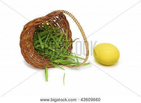 Yellow Easter Egg With A Basket And Grass