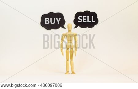 Buy Or Sell Symbol. Wooden Model Of Businessman Human. Black Paper With Words 'buy Sell'. Beautiful