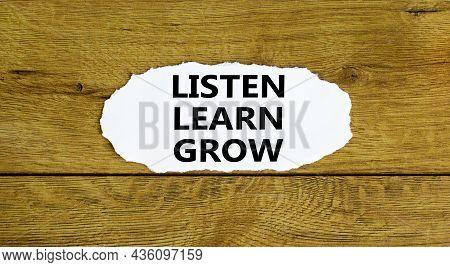 Listen, Learn, Grow Symbol. Words 'listen, Learn, Grow' On White Paper. Beautiful Wooden Background.