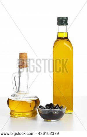 Extra Virgin Olive Oil In A Glass Bottles Isolated On White Background.
