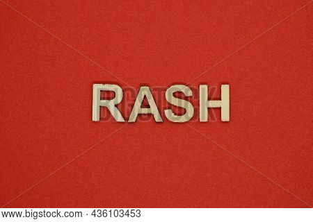 Text The Word Rash From Gray Wooden Small Letters On An Red Table