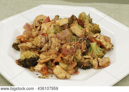 Healthy Ready-to-eat Lunch Of Chicken Meat And A Variety Of Vegetables With Seasoning On A White Oct