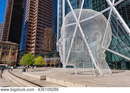 Calgary, Alberta, Canada - 27 September 2021: Wonderland Sculpture By Jaume Plensa In Front Of The B