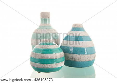 Modern green vases with stripes isolated over white background