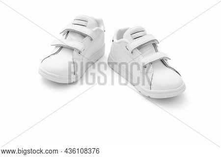 White sneakers with velcro fasteners on white background, including clipping path