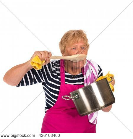 Elder woman tasting with pan and apron isolated over white background