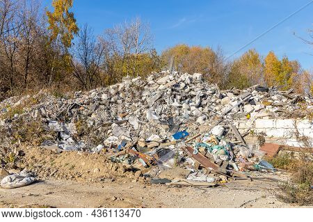 A Pile Of Old Construction Waste. Concrete And Wood Debris, Old Tires And Plastic Debris. Illegal Du