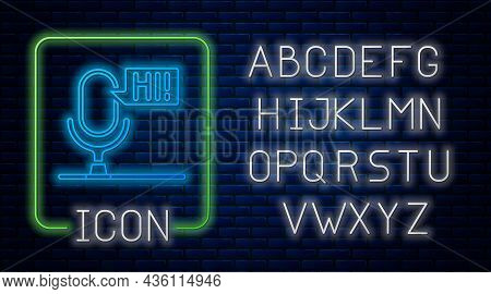 Glowing Neon Microphone Voice Device Icon Isolated On Brick Wall Background. Microphone Interpreter