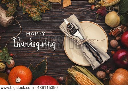 Happy Thanksgiving Background With Festive Table Setting. Pumpkins, Nuts, Fallen Leaves And Spices O
