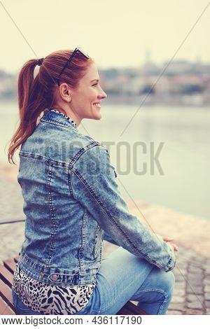 Young Redhead Urban Caucasian Woman Looking Away At City Riverbank, Depth Of Field, Profile View, Bu