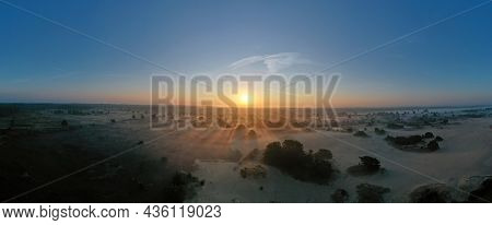 Aerial panorama from the forest Drents Friese Woud in the Netherlands at sunrise