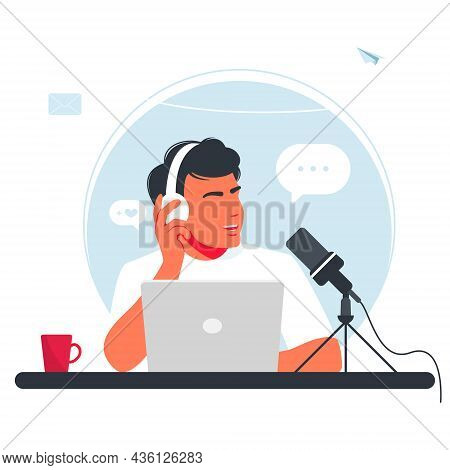 The Man Is Recording A Podcast. Boy In Headphones Talking Into A Microphone. The Radio Dj Is Broadca