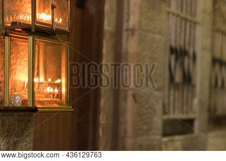 Hanukkah Candles Are Lit At The Entrance To Old Houses In The Jewish Quarter Of Jerusalem
