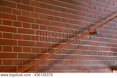 Stairs And Railings With Brown Brick Walls