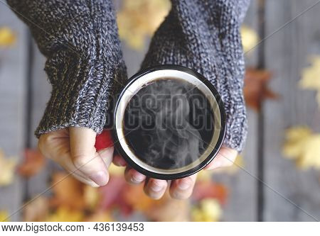Autumn Drink Tea Or Coffee In Hands On The Background Of October Yellow Leaves. Autumn Comfort And M