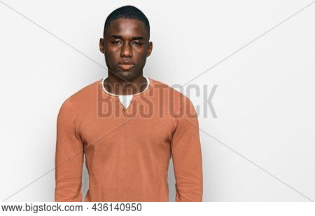 Young african american man wearing casual clothes with serious expression on face. simple and natural looking at the camera.